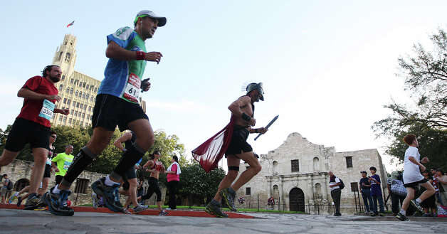 Runners make their way past the Alamo during the Rock 'n' Roll San Antonio Marathon and 1/2 Marathon, Sunday, Nov. 11, 2012. Around 25,000 runners participated in the event. Photo: Jerry Lara, San Antonio Express-News / © 2012 San Antonio Express-News