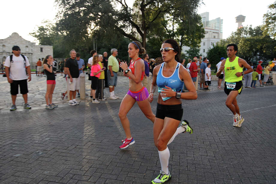 Runners make their way past Alamo Plaza during the Rock 'n' Roll San Antonio Marathon and 1/2 Marathon, Sunday, Nov. 11, 2012. Around 25,000 runners participated in the event. Photo: Jerry Lara, San Antonio Express-News / © 2012 San Antonio Express-News