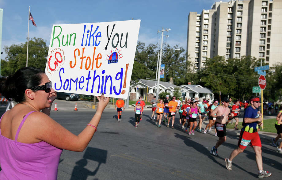 Amy Parra holds a sign as she cheers for runners during the Rock 'n' Roll San Antonio Marathon and 1/2 Marathon Sunday Nov. 11, 2012. Photo: Edward A. Ornelas, San Antonio Express-News / © 2012 San Antonio Express-News