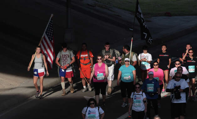 Participants make their way under IH-37 in the Rock 'n' Roll San Antonio Marathon and 1/2 Marathon, Sunday, Nov. 11, 2012. Photo: Jerry Lara, San Antonio Express-News / © 2012 San Antonio Express-News