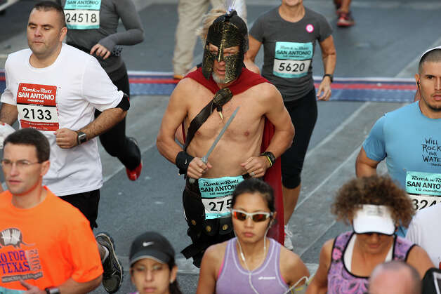 A runner wears a Roman centurion costume during the Rock 'n' Roll San Antonio Marathon and 1/2 Marathon, Sunday, Nov. 11, 2012. Photo: Jerry Lara, San Antonio Express-News / © 2012 San Antonio Express-News