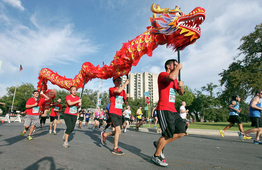 Runners carry a Chinese dragon during the Rock 'n' Roll San Antonio Marathon and 1/2 Marathon Sunday Nov. 11, 2012. Photo: Edward A. Ornelas, San Antonio Express-News / © 2012 San Antonio Express-News