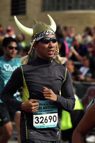Frank Nguyen, of San Antonio, participates in the half marathon of the Rock 'n' Roll San Antonio Marathon and 1/2 Marathon, Sunday, Nov. 11, 2012. Nguyen posted a time of 2:17:51. Photo: Jerry Lara, San Antonio Express-News / © 2012 San Antonio Express-News