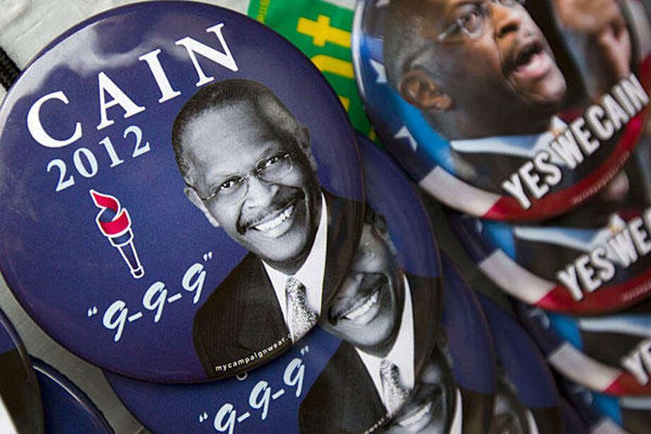 Herman Cain (Dave Martin / AP Photo)