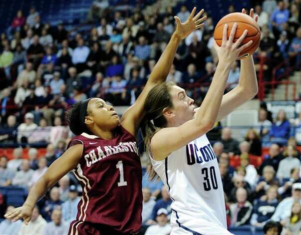 UConn freshman Breanna Stewart (3) drives past Charleston's Alyssa Frye during the  first half of an NCAA college basketball game in Storrs, Conn., Sunday,  Nov. 11, 2012. (AP Photo/Fred Beckham)