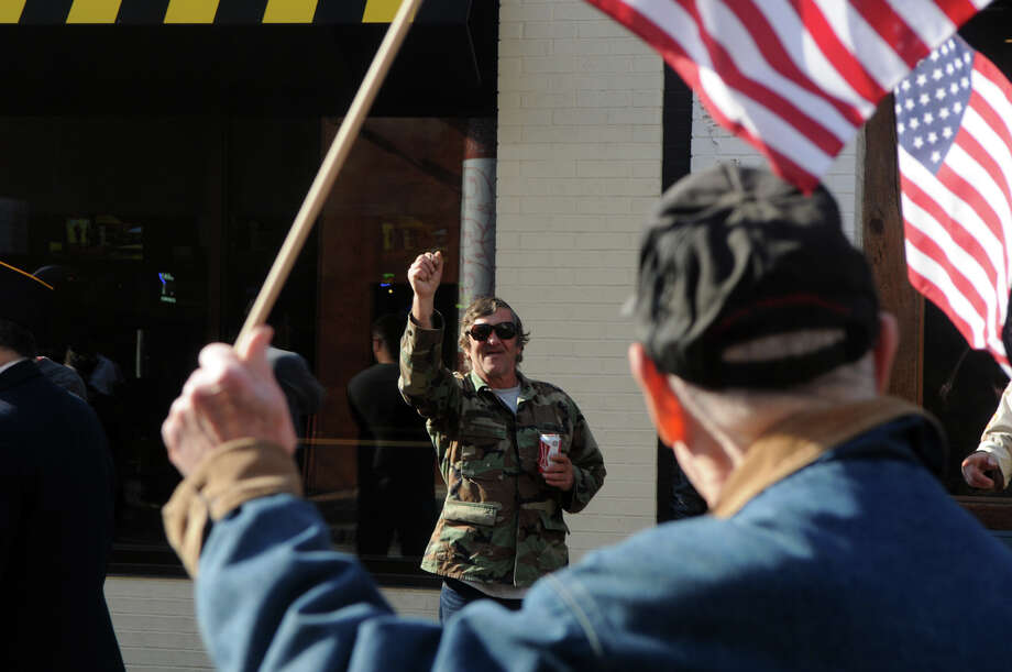 Artie Evenchik wears his nephew's fatigues as he watches Stamford's Annual Veterans Day Parade from Hoyt Street to Veterans Park in Stamford, Conn., Nov. 11, 2012. Photo: Keelin Daly / Stamford Advocate Freelance