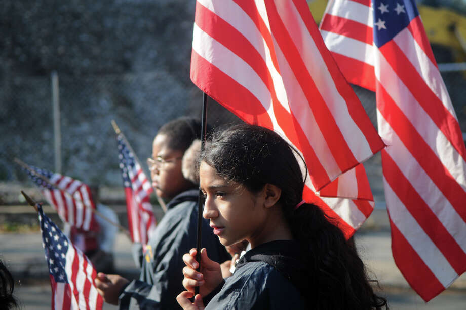 Gabbie Gonzalez marches with Still Meadow and Northeast Schools during Stamford's Annual Veterans Day Parade from Hoyt Street to Veterans Park in Stamford, Conn., Nov. 11, 2012. Photo: Keelin Daly / Stamford Advocate Freelance