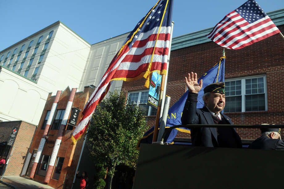 Bill Pace, Vice Commander of the American Legion, waves during Stamford's Annual Veterans Day Parade from Hoyt Street to Veterans Park in Stamford, Conn., Nov. 11, 2012. Photo: Keelin Daly / Stamford Advocate Freelance