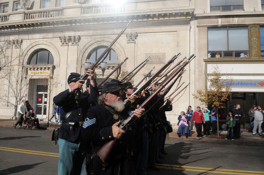 Gary Lehning and the  Civil War Reenactment 11th Regiment Connecticut Volunteer Infantry fire during Stamford's Annual Veterans Day Parade from Hoyt Street to Veterans Park in Stamford, Conn., Nov. 11, 2012. Photo: Keelin Daly / Stamford Advocate Freelance