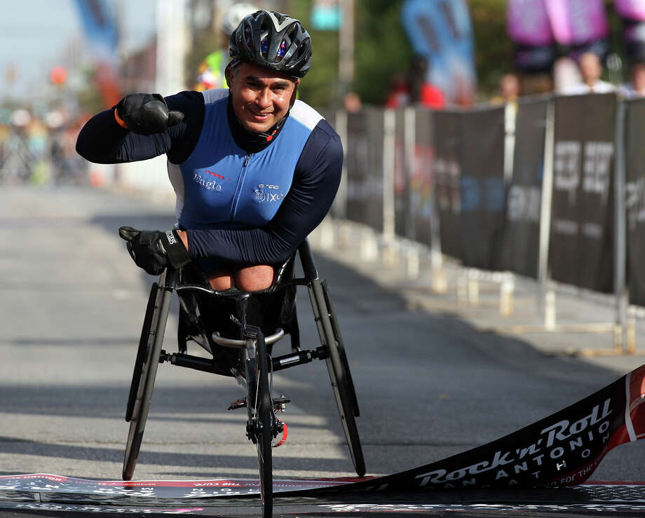 Saul Mendoza, of Wimberley,  comes in at first place in the men's wheelchair marathon division of the Rock 'n' Roll San Antonio Marathon and 1/2 Marathon, Sunday, Nov. 11, 2012. His time was 2:00:57. Photo: Jerry Lara, San Antonio Express-News / © 2012 San Antonio Express-News
