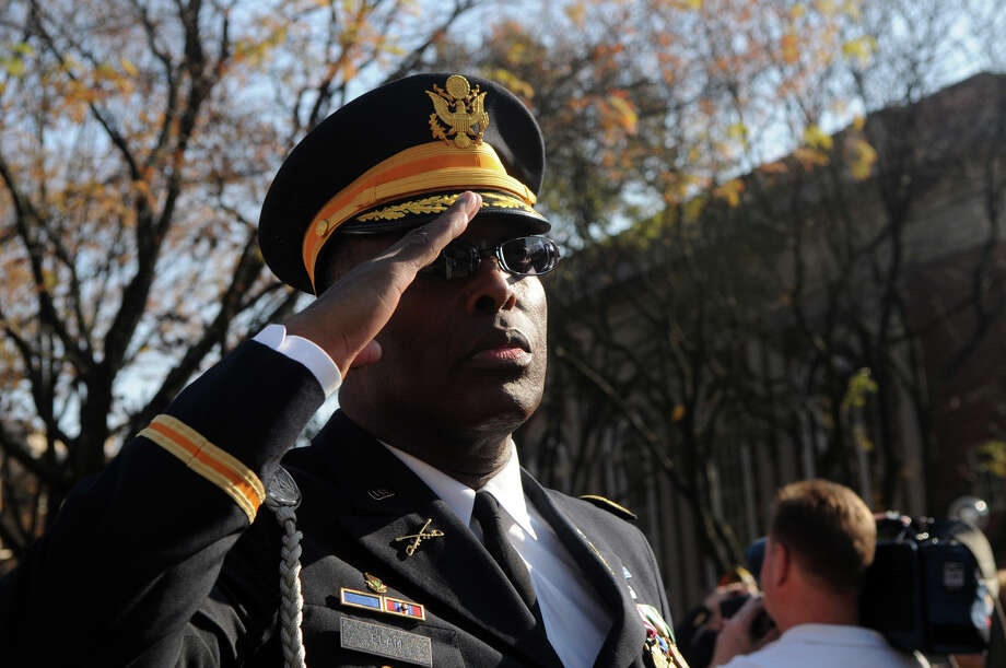 Archie Elam salutes as the flag is raised during Stamford's Annual Veterans Day Parade from Hoyt Street to Veterans Park in Stamford, Conn., Nov. 11, 2012. Photo: Keelin Daly / Stamford Advocate Freelance