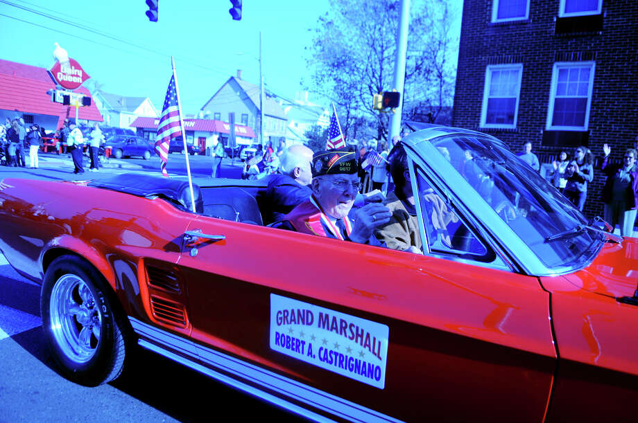 Grand Marshal Robert Castrignano rides along in Stamford's Annual Veterans Day Parade from Hoyt Street to Veterans Park in Stamford, Conn., Nov. 11, 2012. Photo: Keelin Daly / Stamford Advocate Freelance