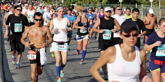Runners make their way around San Pedro Park during the Rock 'n' Roll San Antonio Marathon and 1/2 Marathon Sunday Nov. 11, 2012. Photo: Edward A. Ornelas, San Antonio Express-News / © 2012 San Antonio Express-News