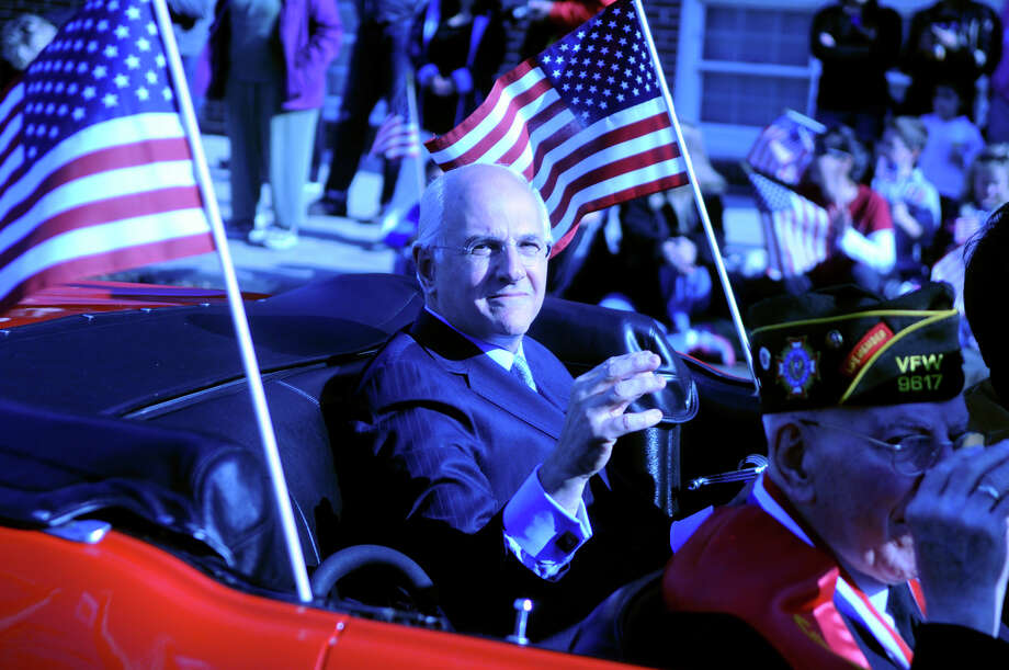Grand Marshal Robert Castrignano's son, also Robert Castrignano, rides with his father in Stamford's Annual Veterans Day Parade from Hoyt Street to Veterans Park in Stamford, Conn., Nov. 11, 2012. Photo: Keelin Daly / Stamford Advocate Freelance