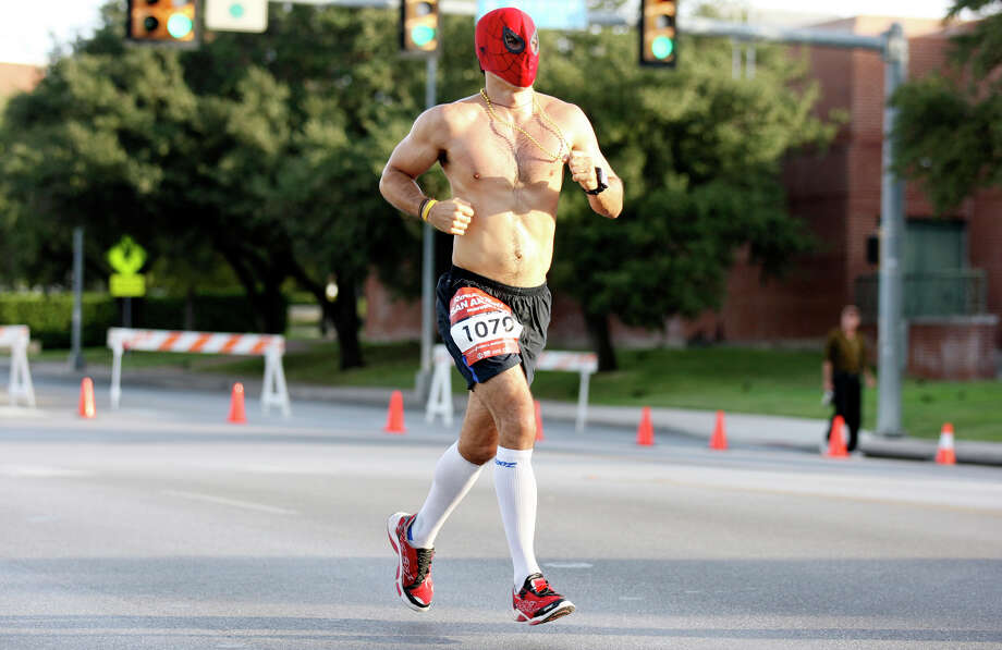 Anthony Harris wears a Spider-Man mask during the Rock 'n' Roll San Antonio Marathon and 1/2 Marathon Sunday Nov. 11, 2012. Harris' half marathon time was 1:31:24. Photo: Edward A. Ornelas, San Antonio Express-News / © 2012 San Antonio Express-News