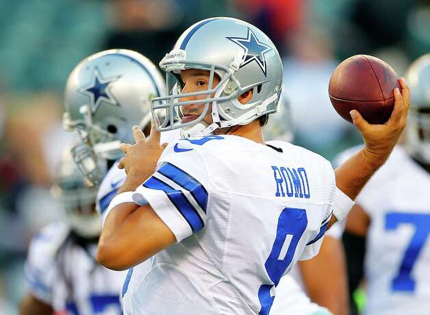 Quarterback Tony Romo #9 of the Dallas Cowboys makes a pass during warm ups before the start of their game against the Philadelphia Eagles at Lincoln Financial Field on November 11, 2012 in Philadelphia, Pennsylvania. Photo: Rich Schultz, Getty Images / 2012 Getty Images