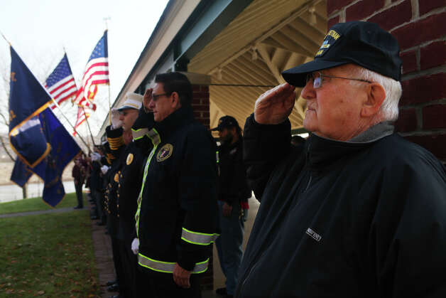 Veteran Jim Martin salutes during the annual American Legion Post 16's Veterans Day Ceremony at Veterans Memorial Park in Shelton, Conn. on November 11, 2012. Martin served in the army for 21 years during the Korean and Vietnam wars. Photo: BK Angeletti, B.K. Angeletti / Connecticut Post freelance B.K. Angeletti