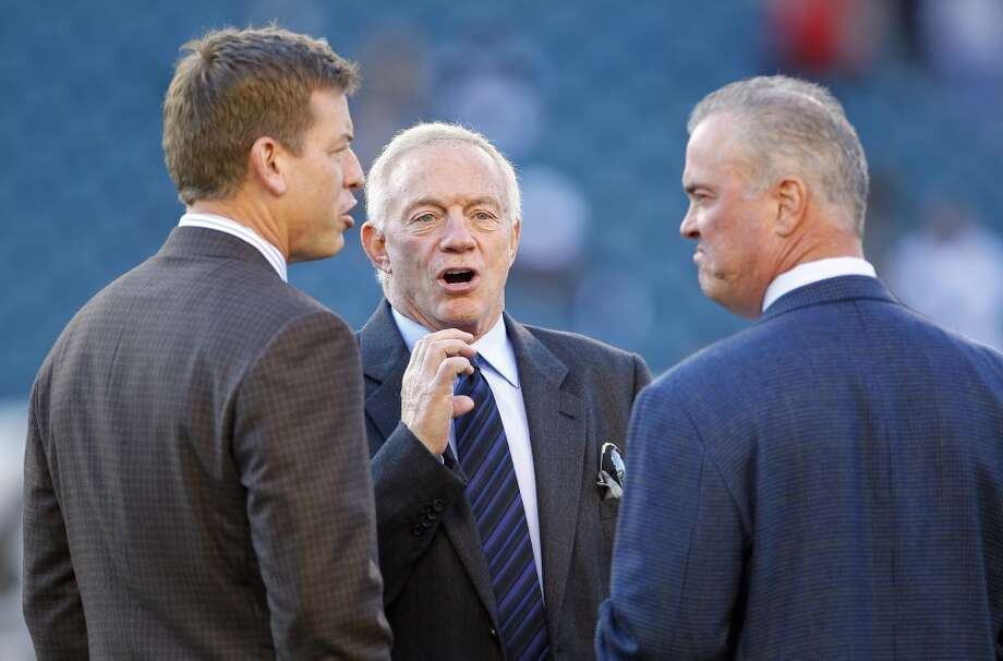 Dallas Cowboys owner Jerry Jones, center, talks with broadcaster and former Cowboys quarterback Troy Aikman, left, and CEO, Stephen Jones, right, before the start of their game against the Philadelphia Eagles at Lincoln Financial Field on November 11, 2012 in Philadelphia, Pennsylvania. (Photo by Rich Schultz /Getty Images) (Getty Images)