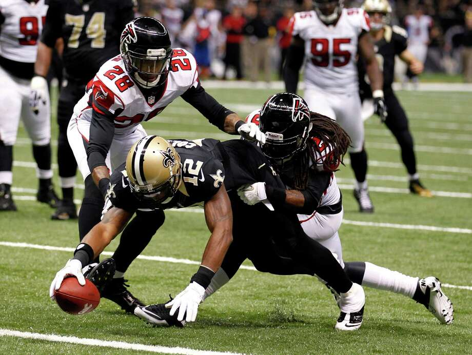 New Orleans Saints wide receiver Marques Colston (12) scores on a touchdown reception as Atlanta Falcons free safety Thomas DeCoud (28) covers in the second half of an NFL football game at Mercedes-Benz Superdome in New Orleans, Sunday, Nov. 11, 2012. (AP Photo/Bill Haber) Photo: Bill Haber, FRE / FR170136 AP