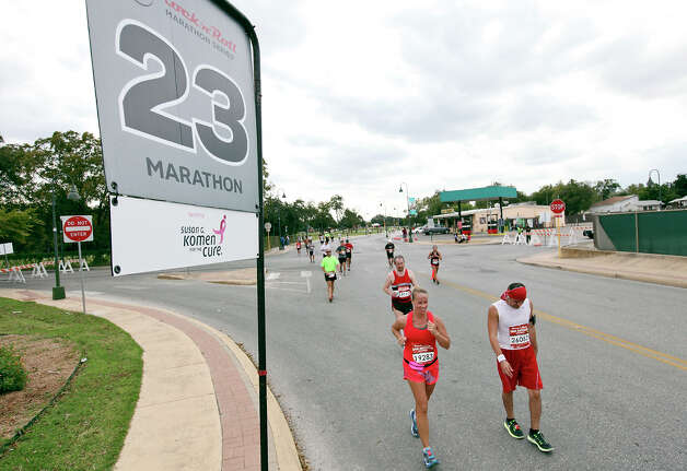 Marathon runners pass the 23-mile marker during the Rock 'n' Roll San Antonio Marathon and 1/2 Marathon Sunday Nov. 11, 2012. Photo: Edward A. Ornelas, San Antonio Express-News / © 2012 San Antonio Express-News