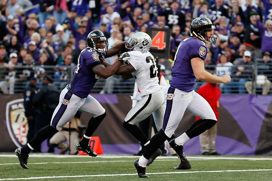 BALTIMORE, MD - NOVEMBER 11:  Holder Sam Koch #4 of the Baltimore Ravens scores a touchdown on a fake field goal during the third quarter against the Oakland Raiders at M&T Bank Stadium on November 11, 2012 in Baltimore, Maryland.  (Photo by Rob Carr/Getty Images) Photo: Rob Carr, Getty Images