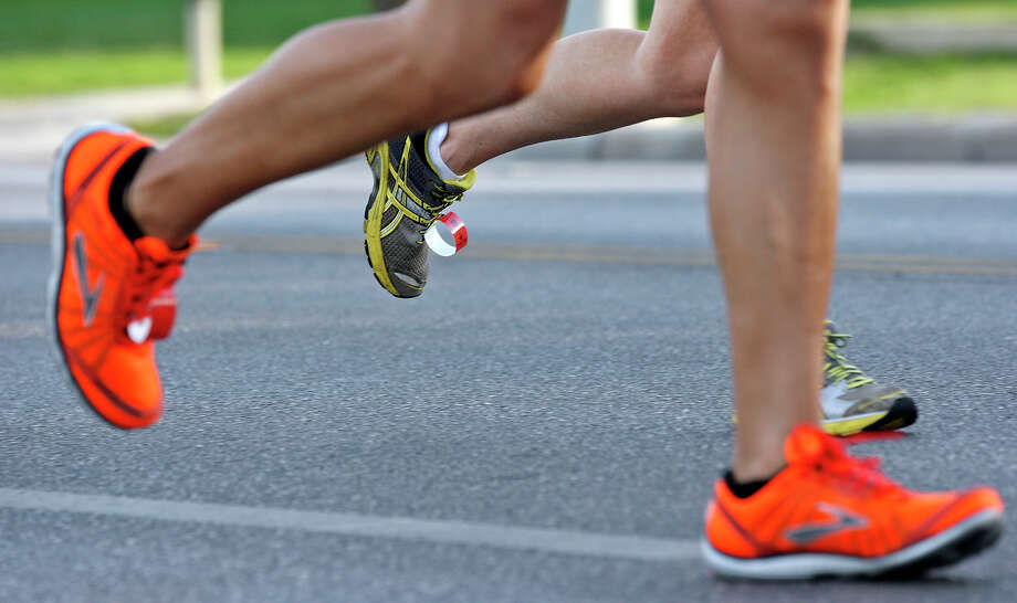 Runners take part in the Rock 'n' Roll San Antonio Marathon and 1/2 Marathon Sunday Nov. 11, 2012. Photo: Edward A. Ornelas, San Antonio Express-News / © 2012 San Antonio Express-News