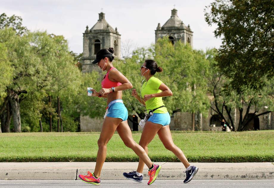 Runners pass Mission Concepción during the Rock 'n' Roll San Antonio Marathon and 1/2 Marathon Sunday Nov. 11, 2012. Photo: Edward A. Ornelas, San Antonio Express-News / © 2012 San Antonio Express-News
