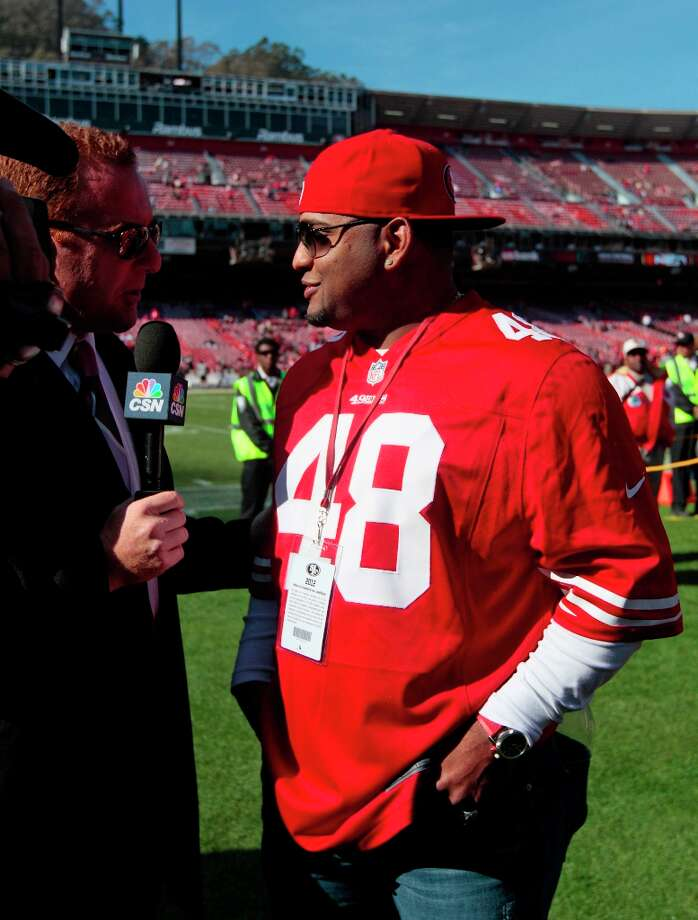 San Francisco Giants third baseman Pablo Sandoval is interviewed on the field of Candlestick Park before the start of an NFL football game between the San Francisco 49ers and the St. Louis Rams in San Francisco, Sunday, Nov. 11, 2012. Photo: Jeff Chiu, Associated Press / AP