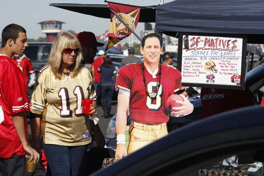 Fans tailgate with former quarterback Steve Young outside Candlestick Park before the San Francisco 49ers play the St. Louis Rams in San Francisco, Calif., on Sunday November 11, 2012. Photo: Brant Ward, The Chronicle / ONLINE_YES