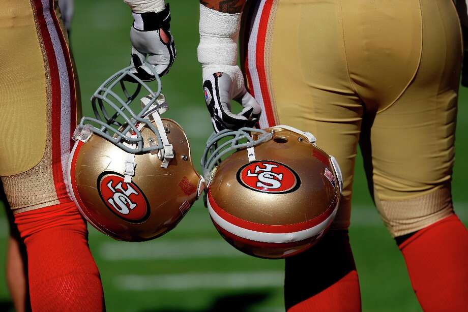 A pair of San Francisco 49ers during warmups before the start of an NFL football game against the St. Louis Rams in San Francisco, Sunday, Nov. 11, 2012. Photo: Marcio Jose Sanchez, Associated Press / AP