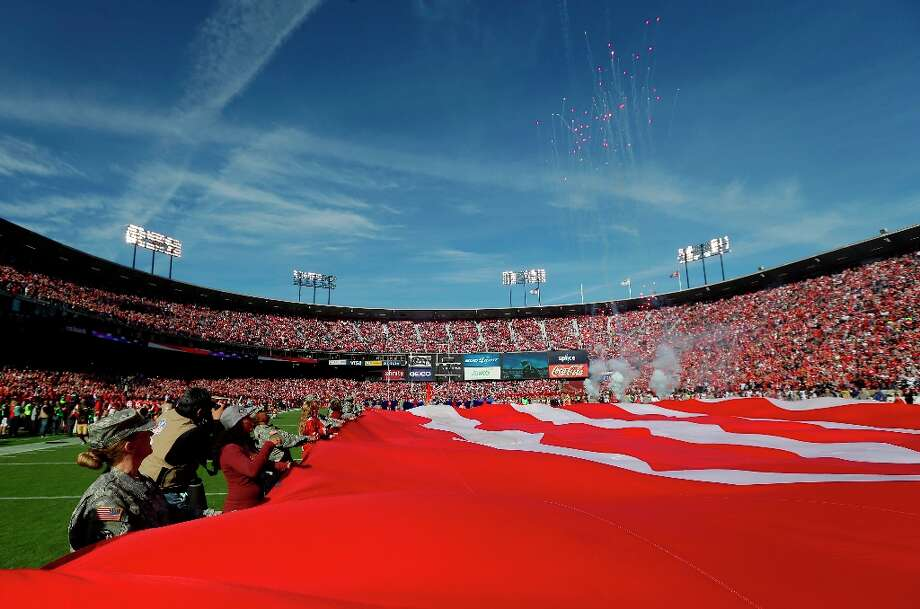 A large flag is held on the field at Candlestick Park in a Salute to Service before the start of an NFL football game between the San Francisco 49ers and the St. Louis Rams in San Francisco, Sunday, Nov. 11, 2012. Photo: Marcio Jose Sanchez, Associated Press / AP