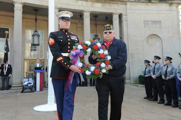 U.S. Marine Sgt. Joseph Bryie and Craig Connolly, of Post 29, an veteran of Vietnam, place the memoral wreath at Greenwich American Legion Post 29's Veterans Day event in front of the War Memorial on Greenwich Avenue in Greenwich, Conn., Sunday, Nov. 11, 2012. Photo: Helen Neafsey / Greenwich Time