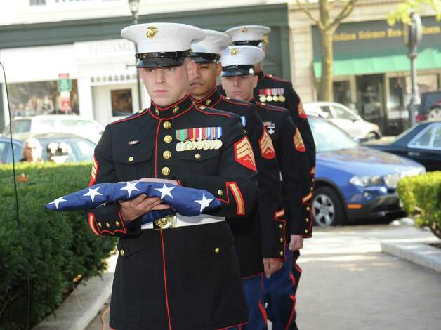 U.S. Marine Sgt. Daniel Ulich, with others, brings the flag at Greenwich American Legion Post 29's Veterans Day event in front of the War Memorial on Greenwich Avenue in Greenwich, Conn., Sunday, Nov. 11, 2012. Photo: Helen Neafsey / Greenwich Time