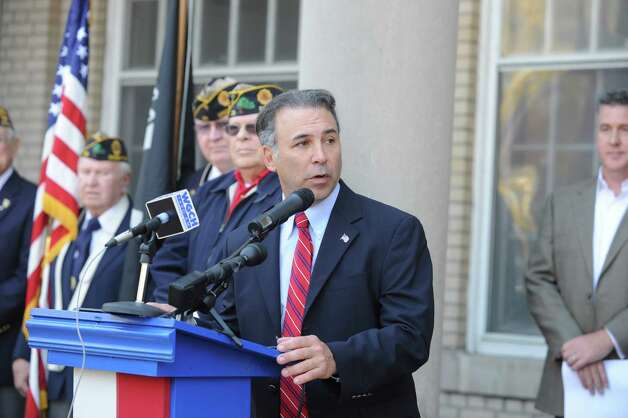 State Rep. Fred Camillo speaks at Greenwich American Legion Post 29's Veterans Day event in front of the War Memorial on Greenwich Avenue in Greenwich, Conn., Sunday, Nov. 11, 2012. Photo: Helen Neafsey / Greenwich Time