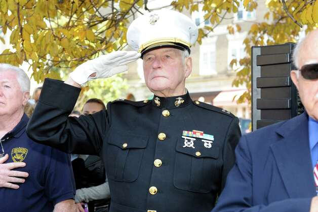 Jim Larkin, a Korean War veteran Capt., salutes the flag at Greenwich American Legion Post 29's Veterans Day event in front of the War Memorial on Greenwich Avenue in Greenwich, Conn., Sunday, Nov. 11, 2012. Photo: Helen Neafsey / Greenwich Time