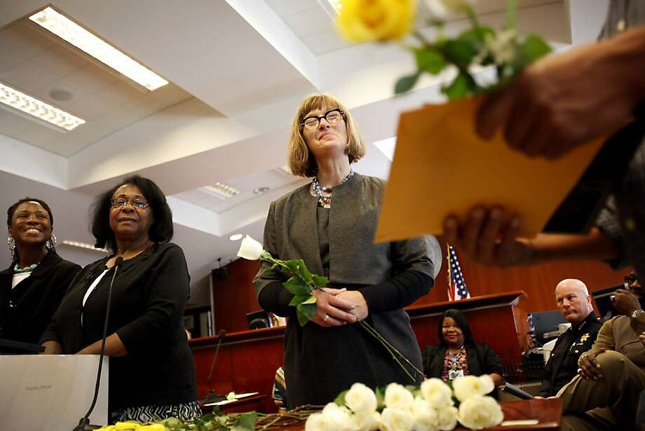 Kate Godsey (center), program coordinator for San Francisco's drug court, listens to a participant give thanks during graduation ceremonies. The program offers rehabilitation as part of criminal justice. Photo: Sarah Rice, Special To The Chronicle