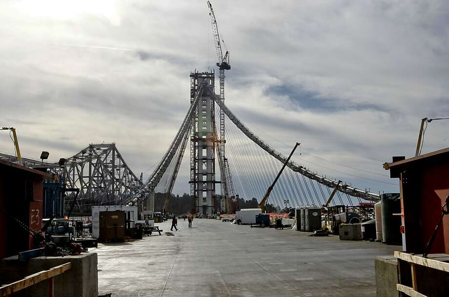 Construction continues on the Bay Bridge's eastern span, where the transfer of 45,000 tons of steel and concrete from the temporary structure is almost done. Photo: Michael Macor, The Chronicle