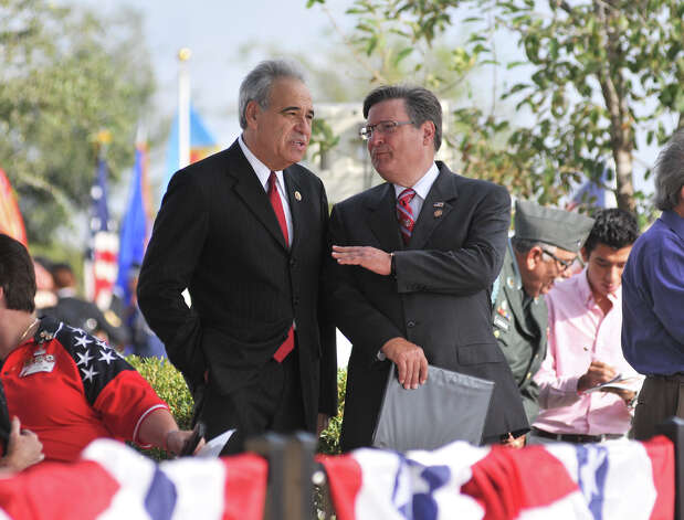 Congressman Charles Gonzalez (left) and Congressman Francisco Canseco talk prior to the start of the Veteran's Day Ceremony at the Fort Sam Houston National Cemetery Sunday morning. Photo: Robin Jerstad, For The Express-News