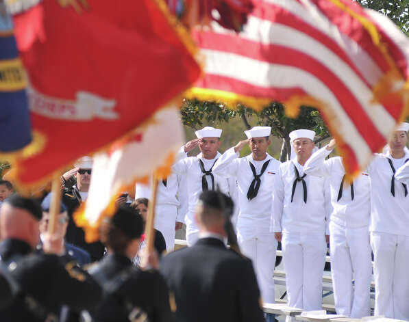 Navy sailors stand at attention as the Joint Services Color Guard presents the colors to begin the Veterans Day Ceremony Sunday morning at the Fort Sam Houston National Cemetery. Photo: For The Express-News