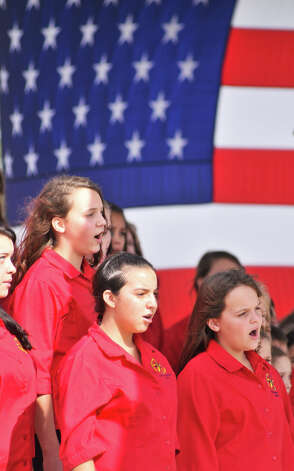 The Texas Children's Choir sings during the Veteran's Day Ceremony at the Fort Sam Houston National Cemetery Sunday morning. Photo: Robin Jerstad/For The Express-Ne