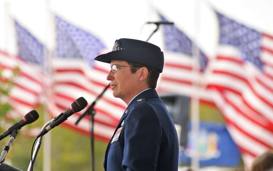 Air Force Brigadadier General Theresa Carter speaks during the Veterens Day Ceremony at Ft. sam Houston National Cemetery Sunday morning. Photo: Robin Jerstad, For The Express-News