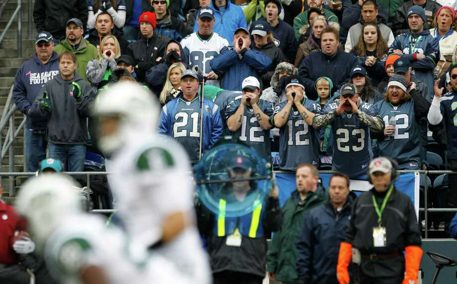 Fans yell during a New York Jets possession against the Seattle Seahawks in the first half of an NFL football game, Sunday, Nov. 11, 2012, in Seattle. Photo: AP