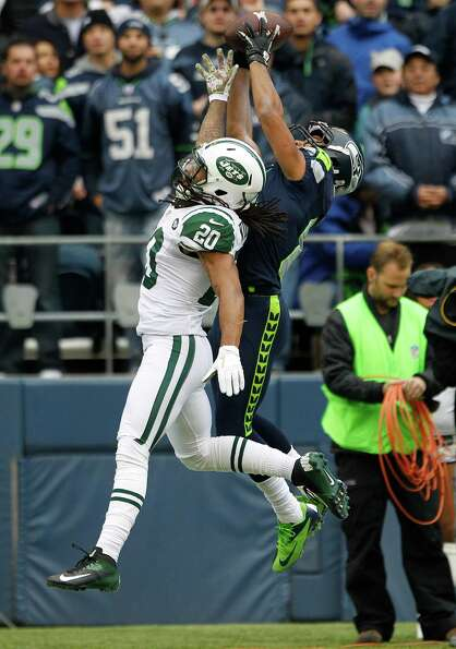 Seattle Seahawks' Golden Tate, right, makes a catch for a touchdown over New York Jets' Kyle Wilson
