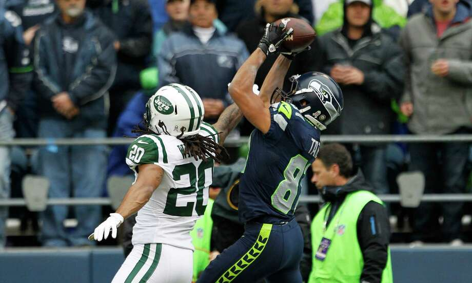 Seattle Seahawks' Golden Tate, right, makes a catch for a touchdown over New York Jets' Kyle Wilson in the first half of an NFL football game, Sunday, Nov. 11, 2012, in Seattle. Photo: AP