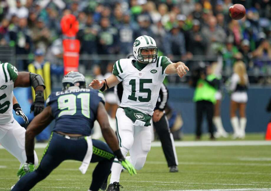 New York Jets' Tim Tebow (15) passes under pressure from Seattle Seahawks' Chris Clemons during the first half of an NFL football game, Sunday, Nov. 11, 2012, in Seattle. Photo: AP