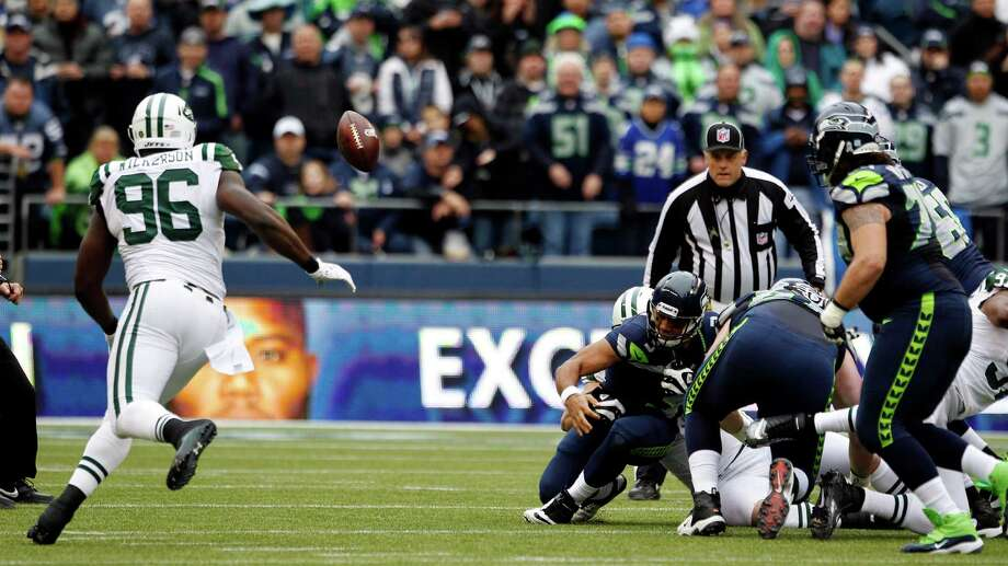 New York Jets' Muhammad Wilkerson (96) recovers a fumble by Seattle Seahawks quarterback Russell Wilson, center, in the first half of an NFL football game, Sunday, Nov. 11, 2012, in Seattle. Wilkerson ran for a touchdown on the play. Photo: AP