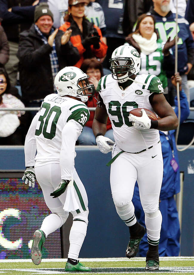 New York Jets' Muhammad Wilkerson (96) celebrates with teammate LaRon Landry (30) after Wilkerson recovered a fumble and ran for a touchdown against the Seattle Seahawks during the first half of an NFL football game, Sunday, Nov. 11, 2012, in Seattle. Photo: AP