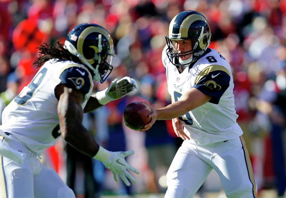 St. Louis Rams quarterback Sam Bradford, right, hands off the ball to running back Steven Jackson, left, during the first quarter of an NFL football game in San Francisco, Sunday, Nov. 11, 2012. Photo: Marcio Jose Sanchez, Associated Press / AP