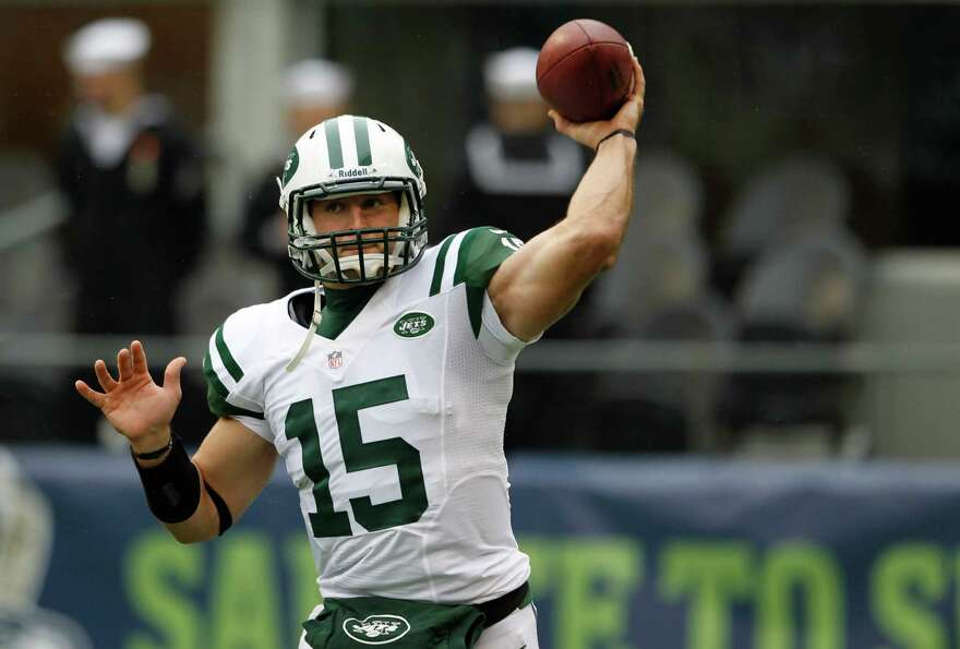 New York Jets backup quarterback Tim Tebow warms up before an NFL football game against the Seattle