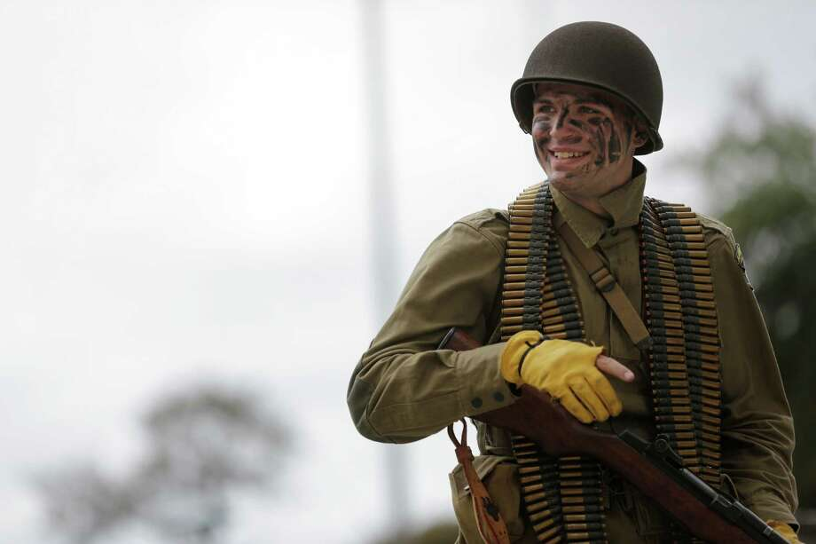 A soldier dressed in World War II attire smiles and waves to the crowd, Sunday, November 11, 2012 during the 2012 Veteran's Day Parade in Downtown Houston, Texas. (TODD SPOTH FOR THE CHRONICLE) Photo: TODD SPOTH, TODD SPOTH / PHOTOGRAPHER / © TODD SPOTH, 2012